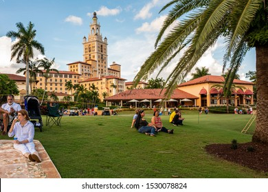 Miami, Florida/USA-July 4th, 2019: Crowd of people celebrating Independence Day at the Biltmore Hotel golf course premises, listening to live music and other amenities while waiting for the fireworks