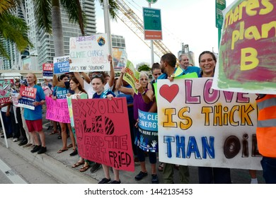Miami, Florida/USA-June 26, 2019: A coalition of environmental groups, march & rallied outside the venue for the Democratic Presidential debate, with signs calling for specific climate change debates