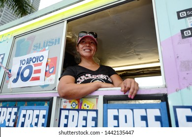 Miami, Florida/USA-June 26, 2019: Joe Biden ice cream truck woman hands out free ice cream cones to reporters and attendees across the 90 degree scorching streets at the Democratic Presidential debate