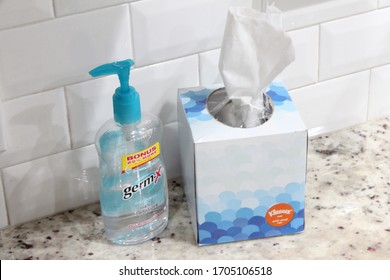 Miami, FL/USA - April 01, 2020: Germ-X Hand Sanitizer and Kleenex Tissue Box, Anti Viral, on marble surface for killing germs due to the COVID-19 pandemic also known as the Coronavirus.