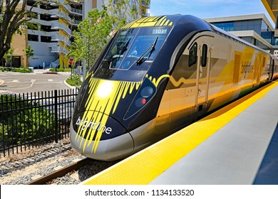 MIAMI, FL/USA - JULY 14, 2018:  Brightline is a high-speed train service between West Palm Beach, Florida and Miami.  This is the train at the station, waiting for passengers to board.