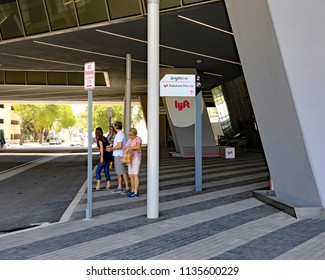 MIAMI, FL/USA - JULY 14, 2018:  The waiting area for the ridesharing LYFT, at the Miami Brightline station.  People are looking for their Lyft car to pick them up.