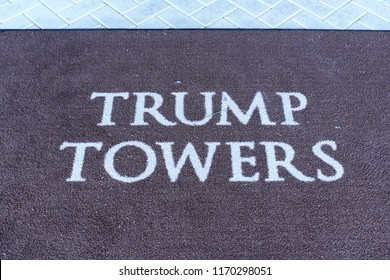 Miami, FL/USA: Nov 29, 2017 – Floor mat  on ceramic entry is stamped with words Trump Towers in Sunny Isles Beach Florida on Collins Avenue outside Miami Florida.