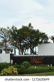 Miami, FL/USA: Nov 29, 2017 – Sign with gold lettering on black granite surrounded by greenery announces entrance to Trump Palace on Collins Avenue in Sunny Isles Beach outside Miami FL.