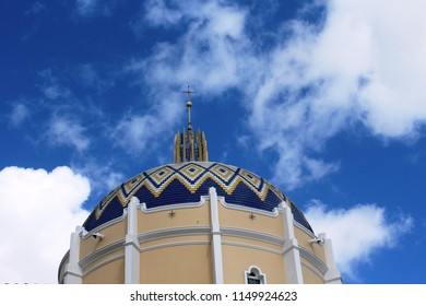 Miami, FL/USA: Nov 30, 2017 –The Cathedral of St. Mary features a tower rising 12 stories capped with glazed tile dome and metal cross. The Catholic parish founded in 1935 built new cathedral in 1957.