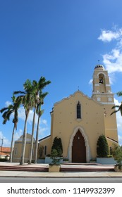 Miami, FL/USA: Nov 30, 2017 – The 1957 Cathedral of St. Mary features stucco exterior, bell tower, and two great mahogany doors, in massive cut keystone frame 30 feet high.