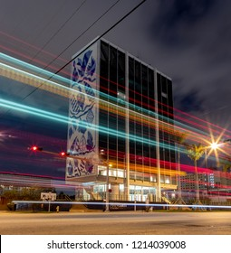 Miami, FL/USA-09/13/2018: The National Young Arts Foundation Building (formerly Bacardi Main Building) at morning blue hour and lit up by light trails of passing traffic.