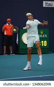 MIAMI GARDENS, FLORIDA - MARCH 23, 2019: Grand Slam champion Roger Federer of Switzerland in action during his round of 32 match at 2019 Miami Open at the Hard Rock Stadium in Miami Gardens, Florida