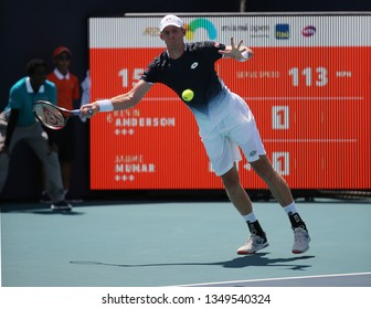 MIAMI GARDENS, FLORIDA - MARCH 23, 2019: Professional tennis player Kevin Anderson of South Africa in action during his round of 32 match at 2019 Miami Open at the Hard Rock Stadium in Miami Gardens