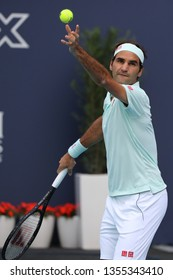MIAMI GARDENS, FLORIDA - MARCH 27, 2019: Grand Slam champion Roger Federer of Switzerland in action during his round of 16 match at 2019 Miami Open at the Hard Rock Stadium in Miami Gardens, Florida
