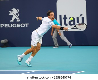MIAMI GARDENS, FLORIDA - MARCH 27, 2019: Professional tennis player Roberto Bautista Agut of Spain in action during his quarter-final match at 2019 Miami Open at the Hard Rock Stadium in Miami Gardens