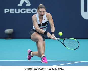 MIAMI GARDENS, FLORIDA - MARCH 27, 2019: Grand Slam Champion Simona Halep of Romania in action during her quarter-final match at 2019 Miami Open at the Hard Rock Stadium in Miami Gardens, Florida