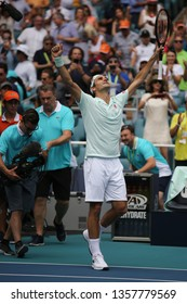 MIAMI GARDENS, FLORIDA - MARCH 31, 2019: Grand Slam champion Roger Federer of Switzerland celebrates victory after his win at 2019 Miami Open final match at the Hard Rock Stadium in Miami Gardens, FL