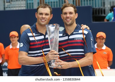 MIAMI GARDENS, FLORIDA - MARCH 31, 2019: 2019 Miami Open doubles Champions Mike and Bob Bryan of USA during trophy presentation at the Hard Rock Stadium in Miami Gardens, Florida