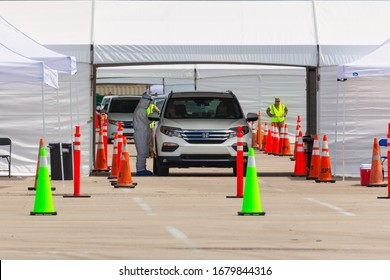 Miami Gardens, Florida, USA. 22 March 2020. COVID-19 Mobile Hospitals. The Florida National Guard open a drive-through testing site for first responders at the Hard Rock Stadium, South Florida