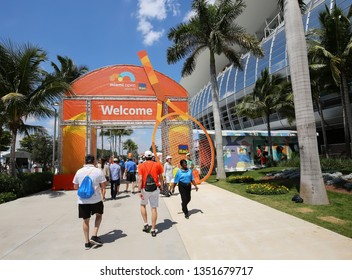 MIAMI GARDENS, FLORIDA, USA - MARCH:  Tennis fans going into the main entrance of the Miami Open at its new home at the Hard Rock Stadium as seen on March 27, 2019.