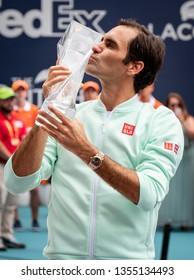Miami Gardens, Florida USA March 31, 2019 - Roger Federer of Switzerland poses with the winners trophy at the finals of the Miami Open at the Hard Rock Stadium on March 31, 2019 in Miami Gardens, Flo