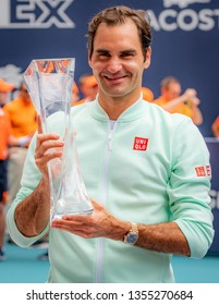 Miami Gardens, Florida USA March 31, 2019 - Roger Federer of Switzerland poses with the winners trophy at the finals of the Miami Open at Hard Rock Stadium on March 31, 2019 in Miami Gardens, Florida