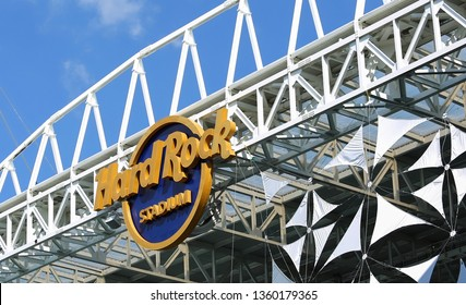 MIAMI GARDENS, FLORIDA, USA - MARCH:  Hard Rock Stadium sign, the Hard Rock will be the venue for the 54th Super Bowl as seen on March 27, 2019.