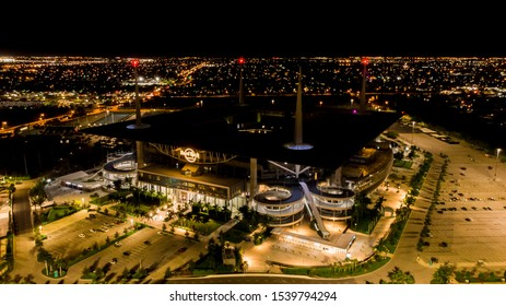 Miami Gardens, Florida/USA - October 23, 2019: Aerial view, drone photography of Hard Rock Stadium located in Miami Gardens. Home stadium of the Miami Dolphins at Night. City Lights. NFL season 2019