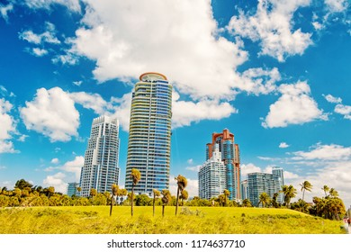 Miami, high residential buildings, hotel or houses in south beach sunny summer outdoor with green grass, miami prperty. real estate. modern architecture in megalopolis. business tourism and wanderlust