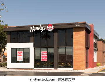 MIAMI - January 13, 2018: Wendy's fast food restaurant exterior and sign. Wendy's is the world's third largest hamburger fast food chain with approximately 6,650 locations.