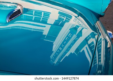 MIAMI - JANUARY 2, 2018: The Art Deco facade of the Breakwater Hotel, built in 1936, reflects on a classic car parked on Ocean Drive in South Beach.