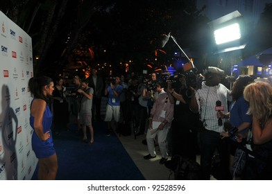 MIAMI - JULY 14: Models, Photographers and guests at the Official opening pool party at Railegh Hotel South Beach for Mercedes-Benz Swim Fashion Week on July 14, 2011 in Miami, FL