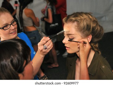 MIAMI - JULY 16: Model getting ready at make-up at the Mara Hoffman Swimsuit Collection for Spring/ Summer 2012 during Mercedes-Benz Swim Fashion Week on July 16, 2011 in Miami, FL