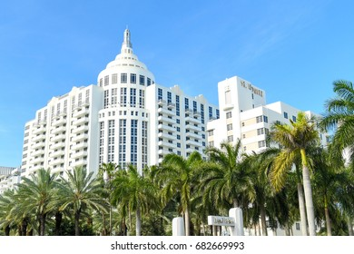 MIAMI - JUNE 15: Loews Miami Beach Hotel in South Beach towers over palm trees on June 15, 2017 in Miami, Florida, USA.