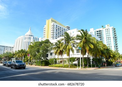 MIAMI - JUNE 15: The sun shines on Collins Avenue with the Royal Palm and Loews Miami Hotel on June 15, 2017 in Miami, Florida, USA.