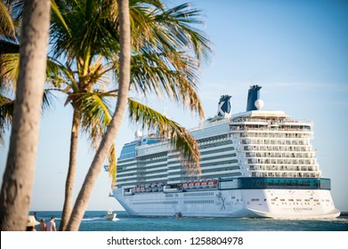 MIAMI - JUNE, 2018: The Celebrity Equinox cruise ship passes South Pointe Park in South Beach as it departs PortMiami, the busiest cruise ship terminal in the world.