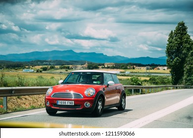 Miami Platja, Girona, Spain - May 19, 2018: Red Mini Hatch Second Generation Driving In Motorway Road.