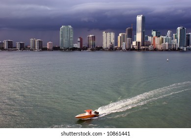 Miami skyline and Biscayne Bay with brightly colored power boat in foreground.