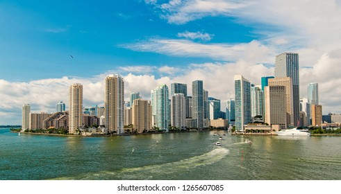 Miami skyline skyscrapers ,yacht or boat sailing next to Miami downtown. Aerial view, south beach