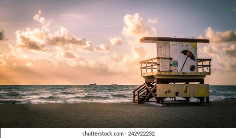 Miami South Beach sunrise with lifeguard tower and coastline with colorful cloud and blue sky, Florida, USA