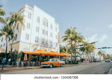 MIAMI, UNITED STATES OF AMERICA - MAY 1st: Ocean Drive Art deco Buildings with vintage cars at South Beach on MAY 1, 2017 in MIAMI, UNITED STATES OF AMERICA