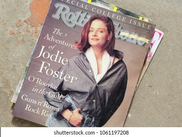 MIAMI, UNITED STATES OF AMERICA, USA - APRIL 02, 2018: Stack of magazines Rolling Stone on top issue March 1991 with Jodie Foster on cover, on display at flea market in Miami, USA.