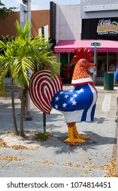 Miami, USA, 03/18/2016, Little Havana. Cock. A symbolic rooster sculpture with flowers of Cuban and American flag  in little Havana.