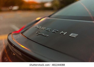 MIAMI, USA - APRIL 30, 2016: Rear view shot Porsche Cayman. Night scene on APRIL 30, 2016 in Miami, USA.