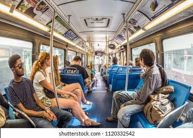 MIAMI, USA - AUG 18, 2014: people in the downtown Metro bus in Miami, USA. Metrobus operates more than 90 routes with close to 1,000 buses covering 41 million miles per year.