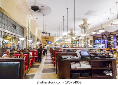 MIAMI, USA - August 2, 2010: people eat inside the famous Jerrys Deli, an old Ard Deco Deli  in Miami, USA.  Jerry Famous Deli was originally built as Hoffman's Cafeteria and opened first in 1939.