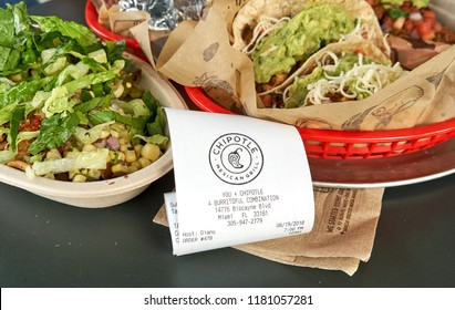 MIAMI, USA - AUGUST 22, 2018: Chipotle plate and receipt. Chipotle restaurant logo. Chipotle Mexican Grill is an American chain of fast casual restaurants