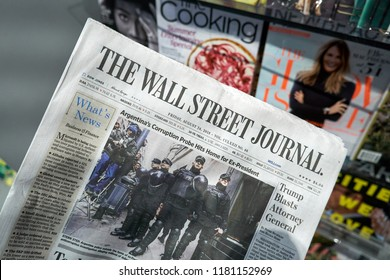 MIAMI, USA - AUGUST 22, 2018: newspaper in a hand. The Wall Street Journal is a popular american business-focused, English-language daily newspaper