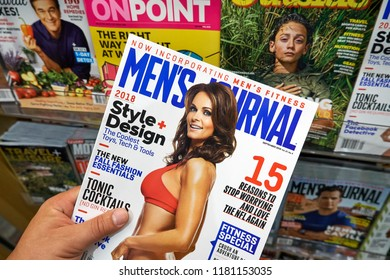 MIAMI, USA - AUGUST 22, 2018: Men's Journal magazine in a hand. Men's Journal is a popular monthly men's lifestyle magazine focused on outdoor recreation