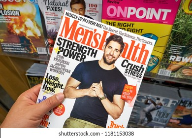 MIAMI, USA - AUGUST 22, 2018: Mens Health magazine in a hand. Men's Health is a popular magazine published by Rodale Inc