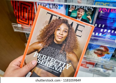 MIAMI, USA - AUGUST 23, 2018: Time magazine with Serena Williams on the cover in a hand. Time is an American weekly news magazine