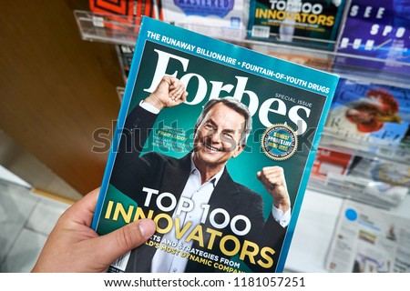 MIAMI, USA - AUGUST 23, 2018: Forbes magazine with Fred Luddy on the cover in a hand. Forbes is an American family-controlled business magazine.