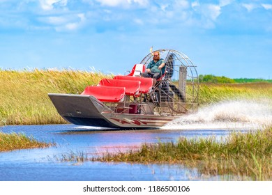 Miami, USA- August 4, 2018: Airboat moving fast in the shallow waters of the Everglades. The area is a National Park and a tourist attraction in the Florida city