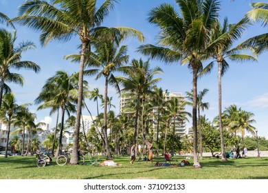 MIAMI, USA - DEC 9, 2015: South Beach Boardwalk with people and palm trees in Miami Beach, Florida, USA